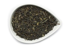 An organic black tea is presented in a white bowl shaped like a tear drop in this high quality fair trade tea from OrganicTeasCanada.com.  One can almost see the freshness in the leaves of this premium true Darjeeling tea now available in Canada.