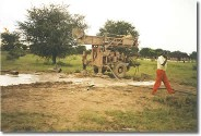 An older drill for drilling wells is pictured.  A project of Plan Canada's clean water initiatives committed to providing clean potable water to impoverished areas throughout the world.  Organic Teas Canada directs five cents of every dollar of gross sales to these admirable projects.