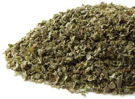 Fresh dried vibrant green Marjoram spice is displayed on a white background.  Another reasonably priced organic spice from Organic Teas Canada dot com.