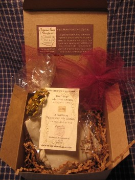 A beautiful gift box is pictured open with three organic cotton bags containing exceptional quality organic mulling spices displayed in a compostable cello bag with tag reading Best Ever Mulling Spices.  Organic Teas Canada dot com gift boxes make useful, unique, reasonably priced handmade gifts in Sandy Hook Manitoba, Canada.